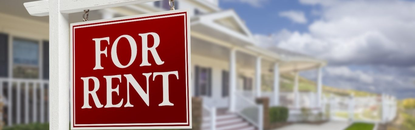 for rent sign in front of first rental property