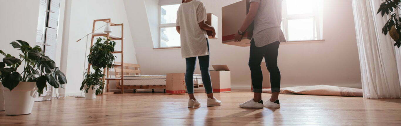 Young couple moves into their rental home